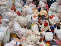 view--kada - assorted dolls in awashima jinja