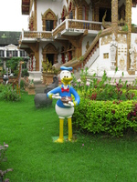 donal duck in buddhist temple Chiang Mai, South East Asia, Thailand, Asia