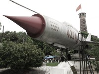 view--mig 21 fighter no 4324 and flag tribune Hanoi, South East Asia, Vietnam, Asia